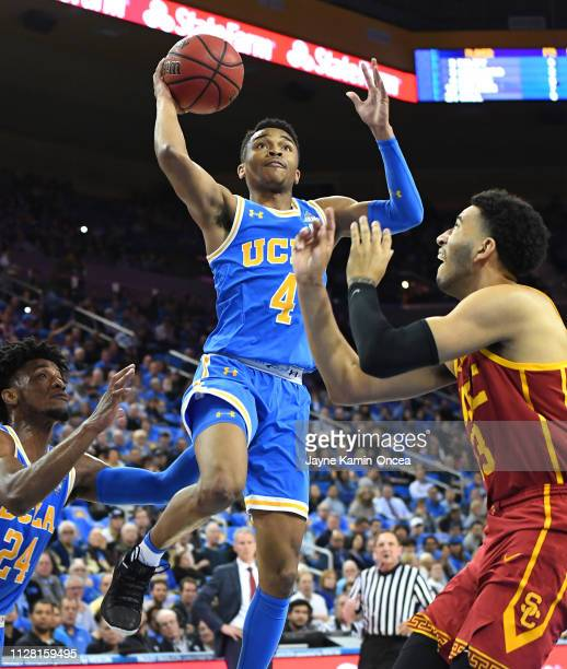 Raan Brooks of the USC Trojans guards Jaylen Hands of the UCLA Bruins as he goes for a basket in the first half of the game at Pauley Pavilion on...
