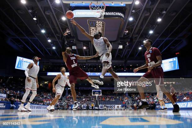 Raasean Davis of the North Carolina Central Eagles blocks a shot by Donte Clark of the Texas Southern Tigers in the first half during the First Four...