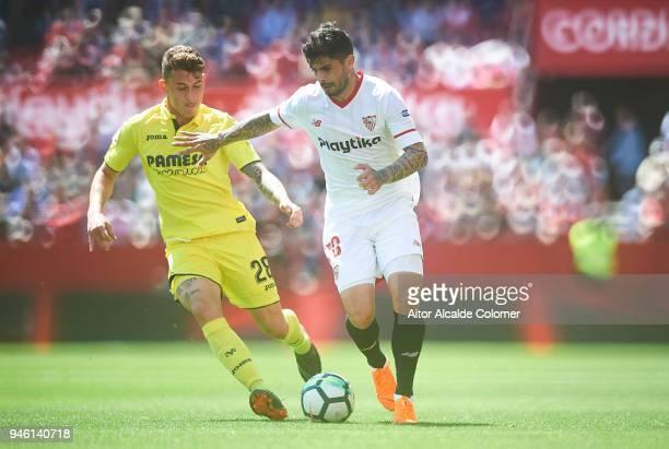 Raba of Villarreal CF competes for the ball with Ever Banega of Sevilla FC during the La Liga match between Sevilla and Villarreal at on April 14...