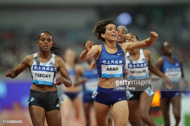 Rababe Arafi of Morocco celebrates after winning the Women 1500m Final of the 2019 IAAF Diamond League at Shanghai Stadium on May 18, 2019 in...