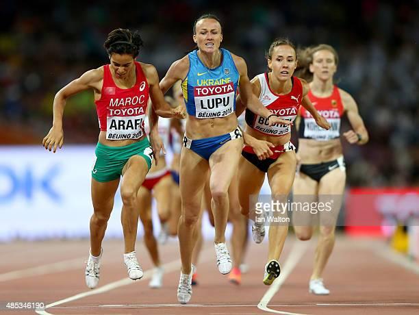Rababe Arafi of Morocco Nataliia Lupu of Ukraine and Selina Buchel of Switzerland cross the finish line in the Women's 800 metres semifinal during...