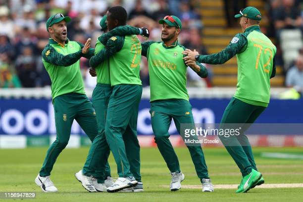 Rabada of South Africa is congratulated by Faf du Plessis Quinton de Kock Aiden Markram and Rassie van der Dussen after taking the wicket of Colin...