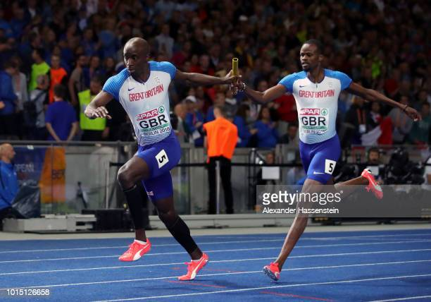 Rabah Yousif of Great Britain passes the baton to teammate Dwayne Cowan in the Men's 4 x 400m Relay Final during day five of the 24th European...