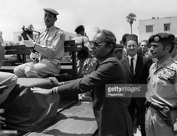 Rabat Morocco 19th July 1971 King Hassan II of Morocco touches the coffin of one of the victims of the abortive coup and assassination attempt on his...