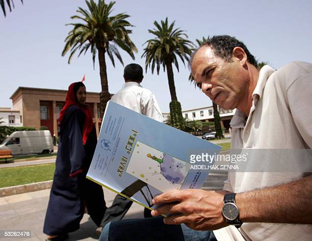 Lahbib Fouad researcher at the Royal Institute of the Amazigh Culture poses in Rabat 20 July 2005 with a Berber edition of Antoine de SaintExupery's...
