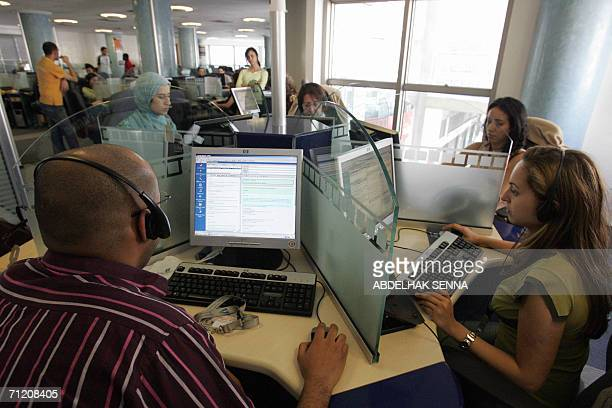 Moroccan agents are pictured at a call center in Rabat 14 June 2006 Morocco has become the world leader of Frenchlanguage offshore calling centers...