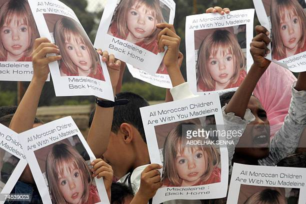 Moroccan children hold placards showing portraits of Madeleine McCann the British girl who vanished in Portugal more than a month ago 11 June 2007...