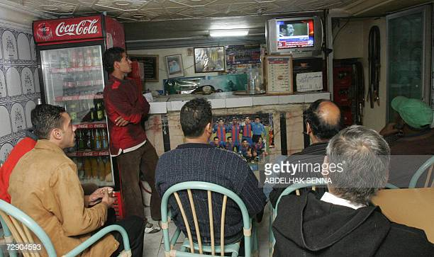 Moroccan residents watch images of Iraqi state television showing a brief film of ousted dictator Saddam Hussein before being placed in a noose by...