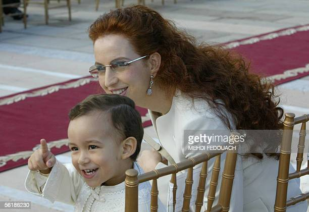 The son of Moroccan King the Crown Prince Hassan points whilst his mother the Princess Lalla Salma looks towards his gesture 16 November 2005 as the...