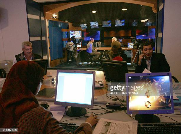 TO GO WITH AFP STORY IN FRENCH Le Maghreb attise les convoitises des chaines arabes Journalists work at AlJazeera's channel regional bureau in Rabat...