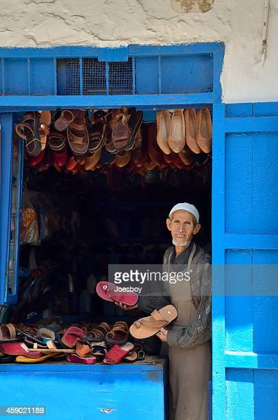 rabat shoe vendor in kasbah des oudaias - rabat morocco stock pictures, royalty-free photos & images