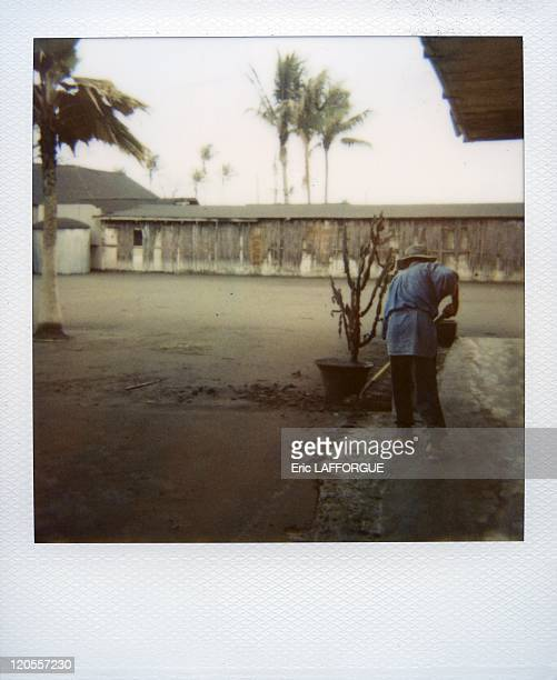 Rabaul hotel in Papua New Guinea The never ending job sweeper at the Rabaul Hotel at the feet of the spitting Tavurvur volcano Every day this man has...