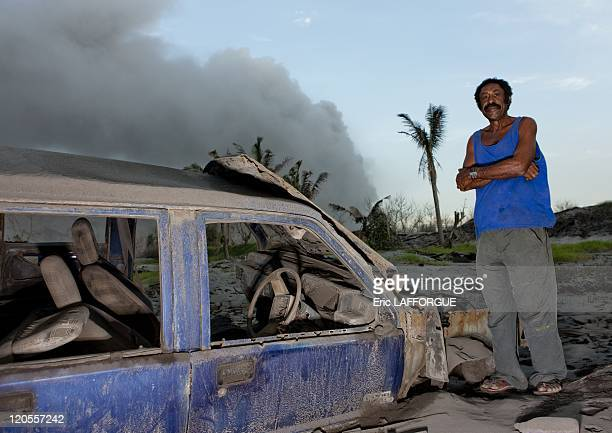 Rabaul in New Britain Papua New Guinea on September 29 2009 Mr Jewakauckesa with his car in front of Rabaul Tavurvur Volcano He was a deputy mayor of...