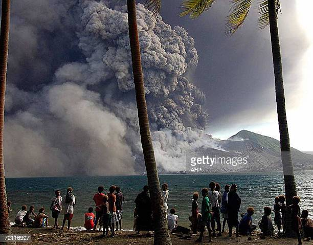 Evacuated Matapit Islanders watch Tavurvur volcano erupt on New Britain Island in Papua New Guinea 07 October 2006 Tavurvur erupted violently sending...