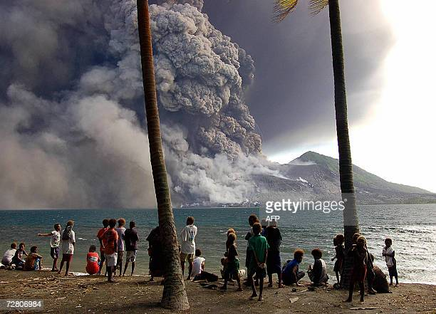 Evacuated Matapit Islanders watch Tavurvur volcano erupt sending ash and rocks over the already devastated city of Rabaul on New Britain Island in...