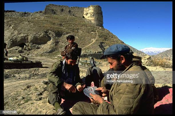 Rabbani govt soldiers playing cards at fort garrison above city calm w rout of Hekmatyar mujahedin by dominant civil war Taliban faction