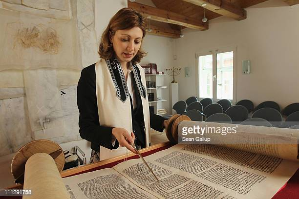 Rabbi Alina Treiger sings as she reads from a torah scroll in the small synagogue on March 31, 2011 in Oldenburg, Germany. Treiger is Germany's first...