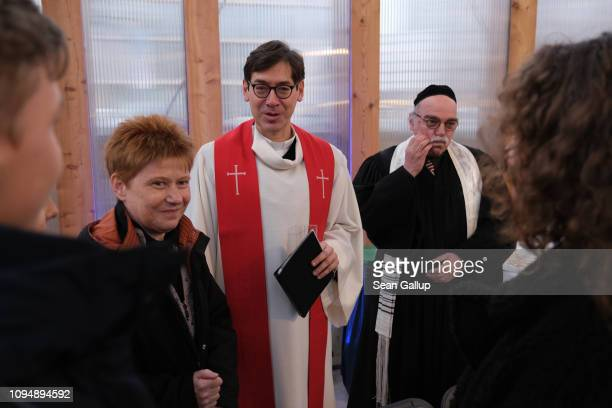 Rabbi Andreas Nachama and Protestant priest Gregor Hohberg chat with politician Petra Pau prior to speaking at the finissage of the House of One...