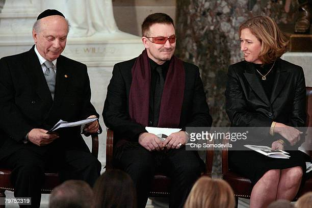 Rabbi Arthur Schneier singer and activist Bono and Israeli Foreign Minister Tzipi Livni participate in a memorial service for House Foreign Affairs...