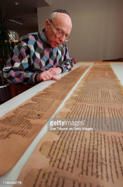 Rabbi Bernard Raskas examined the replicas of the Dead Sea Scrolls that be hand carried from Israel to the Macalester College Library where the...