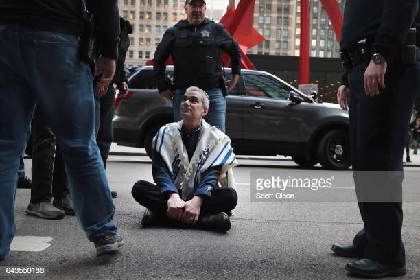 Rabbi Brant Rosen is arrested during a protest against President Donald Trump's proposed policies on combating crime on February 21 2017 in Chicago...