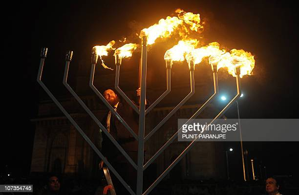 Rabbi Chanoch Gechtman lights a Menorah in front of the Gateway of India to celebrate the ongoing Jewish festival of Hanukkah in Mumbai on December 6...