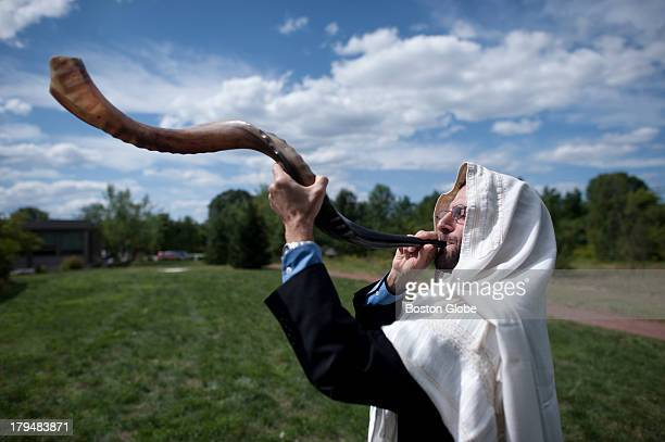 Rabbi Darby Leigh practiced blowing the Shofar at Congregation Kerem Shalom in Concord, Mass. Leigh began his post this August and is the first deaf...