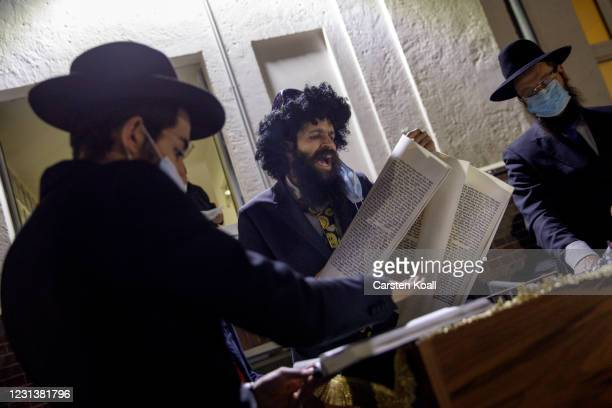 Rabbi David Gewertz reads beside Rabbi Yehuda Teichtal from the prayer rolls during an open-air religious service to celebrate the beginning of the...