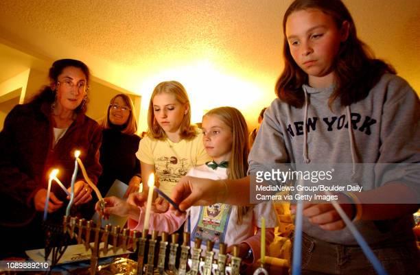 Rabbi Deborah Bronstein left of Congregation Har HaShem and children Sara Freedman Emma Freedman and Rosa Baum light the first candle in their...