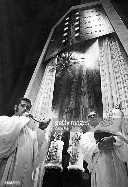 SEP 21 1970 SEP 26 1970 Rabbi Earl S Stone right spiritual leader of Congregation Emanuel carries Torah from 24foot marble ark to the lectern Rabbi...