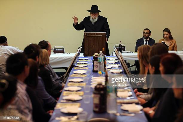 Rabbi Efraim Katz leads a community Passover Seder at Beth Israel synagogue on March 25 2013 in Miami Beach Florida The community Passover Seder that...