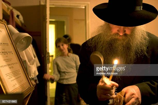 Rabbi Gluck searching for chametz at the beginning of Passover After the house is cleaned from top to bottom the children in the house hide 10...