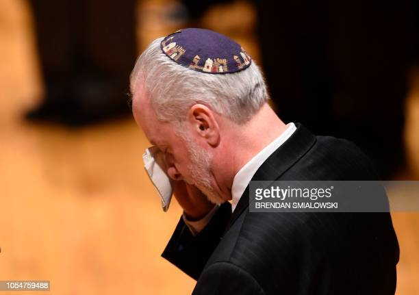 Rabbi Hazzan Jeffrey Myers from the Tree of Life synagogue cries during a vigil to remember the victims of the shooting at his synagogue the day...