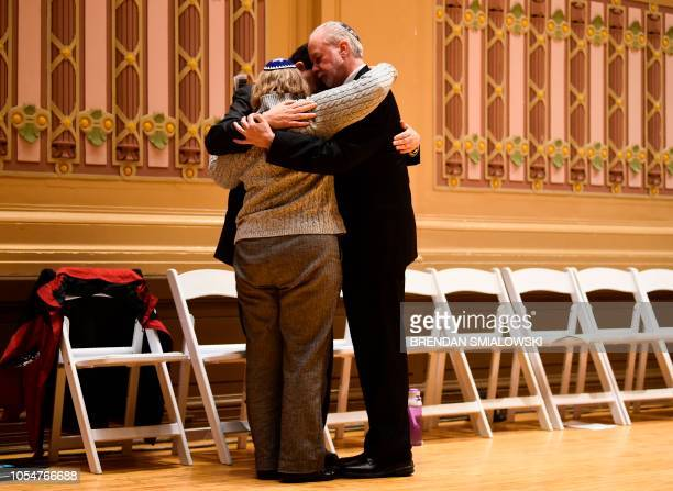 Rabbi Hazzan Jeffrey Myers from the Tree of Life synagogue hugs other rabbi's that were leading services at the synagogue when it was attacked during...