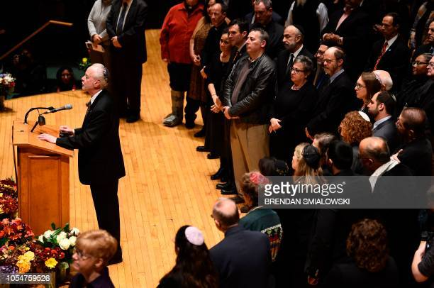 Rabbi Hazzan Jeffrey Myers from the Tree of Life synagogue speaks during a vigil to remember the victims of the shooting at his synagogue the day...