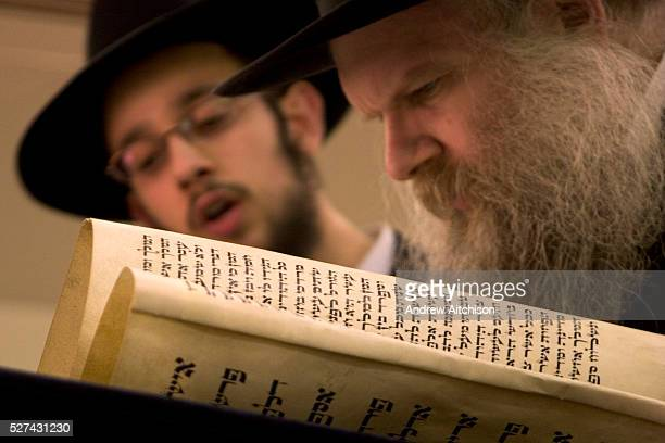 Rabbi Herschel Gluck of Walford road Synagogue reads the Megillah 'The Scroll of Esther' during the Jewish festival of Purim