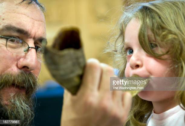 Rabbi Hillel Baron holds the Shofar he and the preschoolers made so that Hannah Lippe can try to blow it Wednesday September 28 2011 in Columbia MD...
