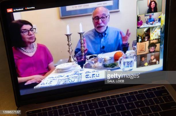 Rabbi Jeffrey Bennett of Temple Sinai in Newington Connecticut hosts a virtual community Seder on Zoom during the first night of Passover as seen on...