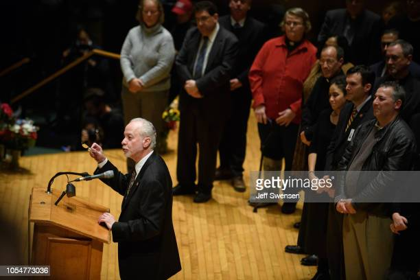 Rabbi Jeffrey Myers speaks to thousands at the Soldiers and Sailors Memorial Hall during a service to honor and mourn the victims of Saturday's mass...