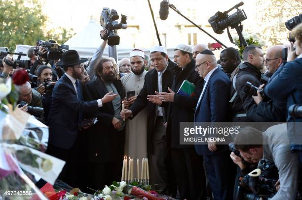 Imam of one of the Nimes Mosques Hocine Drouiche French author Marek Halter Imam of the Drancy Mosque Hassen Chalghoumi and representatives of the...