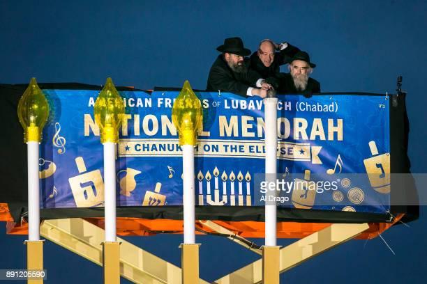Rabbi Levi Shemtov National Economic Director Gary Cohn and Rabbi Abraham Shemtov light the Menorah during the annual National Menorah Lighting in...