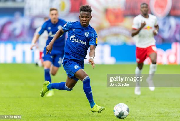 Rabbi Matondo Baba of VfL Wolfsburg runs with the ball during the Bundesliga match between RB Leipzig and FC Schalke 04 at Red Bull Arena on...