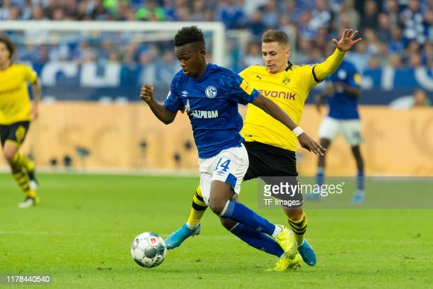 Rabbi Matondo of FC Schalke 04 and Thorgan Hazard of Borussia Dortmund battle for the ball during the Bundesliga match between FC Schalke 04 and...