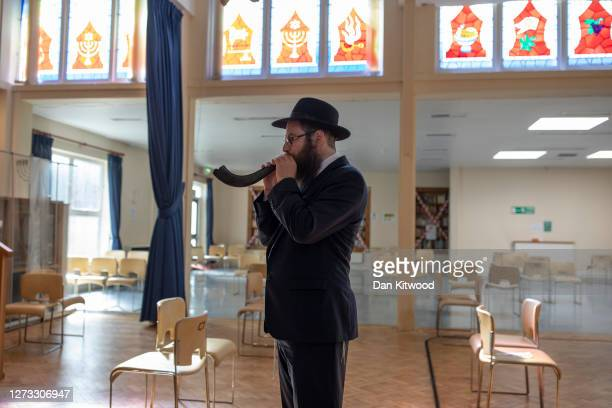 Rabbi Michael Wollenberg from the Woodford Forest United Synagogue demonstrates the blowing of a Shofar on September 18, 2020 in London, England. The...