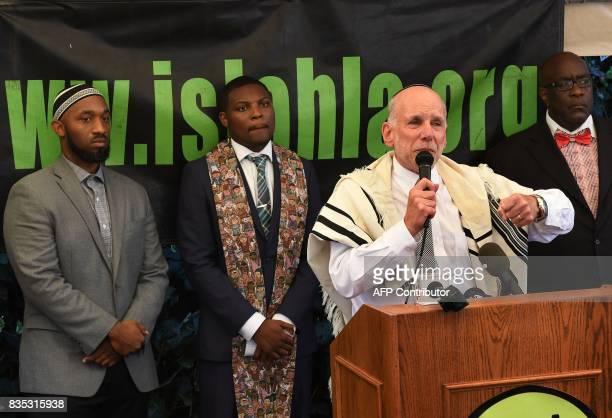 Rabbi Nel ComessDaniels speaks beside a coalition of Islamic Christian and Jewish religious leaders during a 'Rally Against White Supremacy' in Los...