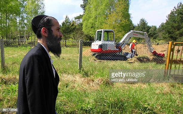 A rabbi of the Society for the Preservation of Jewish Holy Sites 'Athra Kadisha' arrive at the site of what is thought to be a mass grave containing...