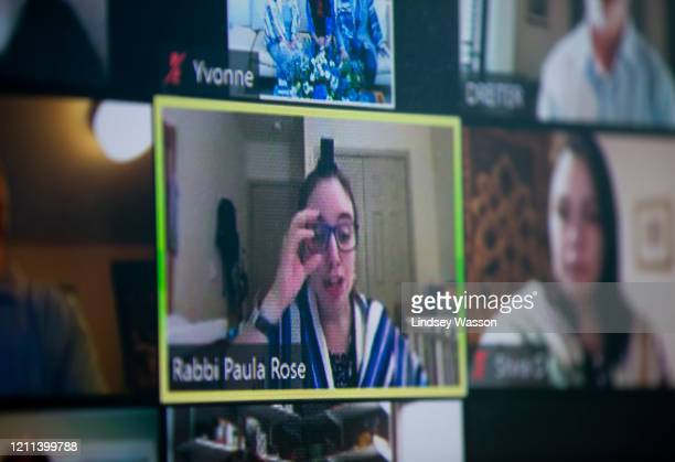 Rabbi Paula Rose speaks as Yvonne Reiter celebrates her bat mitzvah ceremony at home over Zoom due to the coronavirus pandemic on April 30, 2020 in...