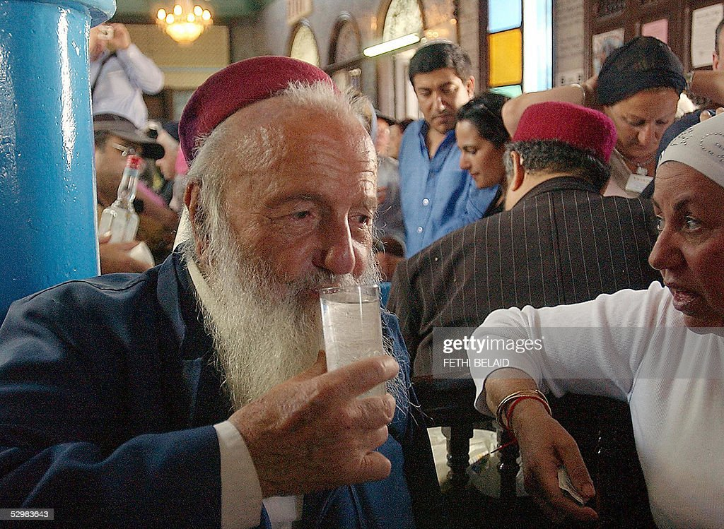 Rabbi Razi Mazouzi drinks a glass of Bou : News Photo