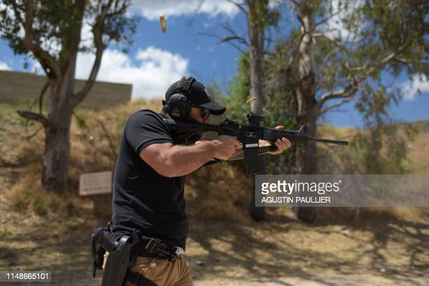 "Rabbi Raziel Cohen, aka ""Tactical Rabbi"", shoots an AR-15 style semi-automatic rifle during a demonstration at the Angeles Shooting Ranges in..."