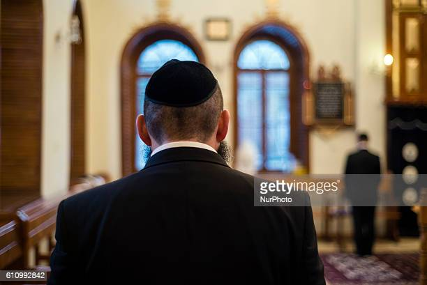 Rabbi reads words of prayer during Mincha service in the Sixdomed Synagogue in Qrmz Qsb or Red Town Quba district of Azerbaijan on 28 September 2016...